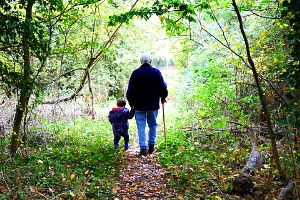 grandad and buddy on wooded path